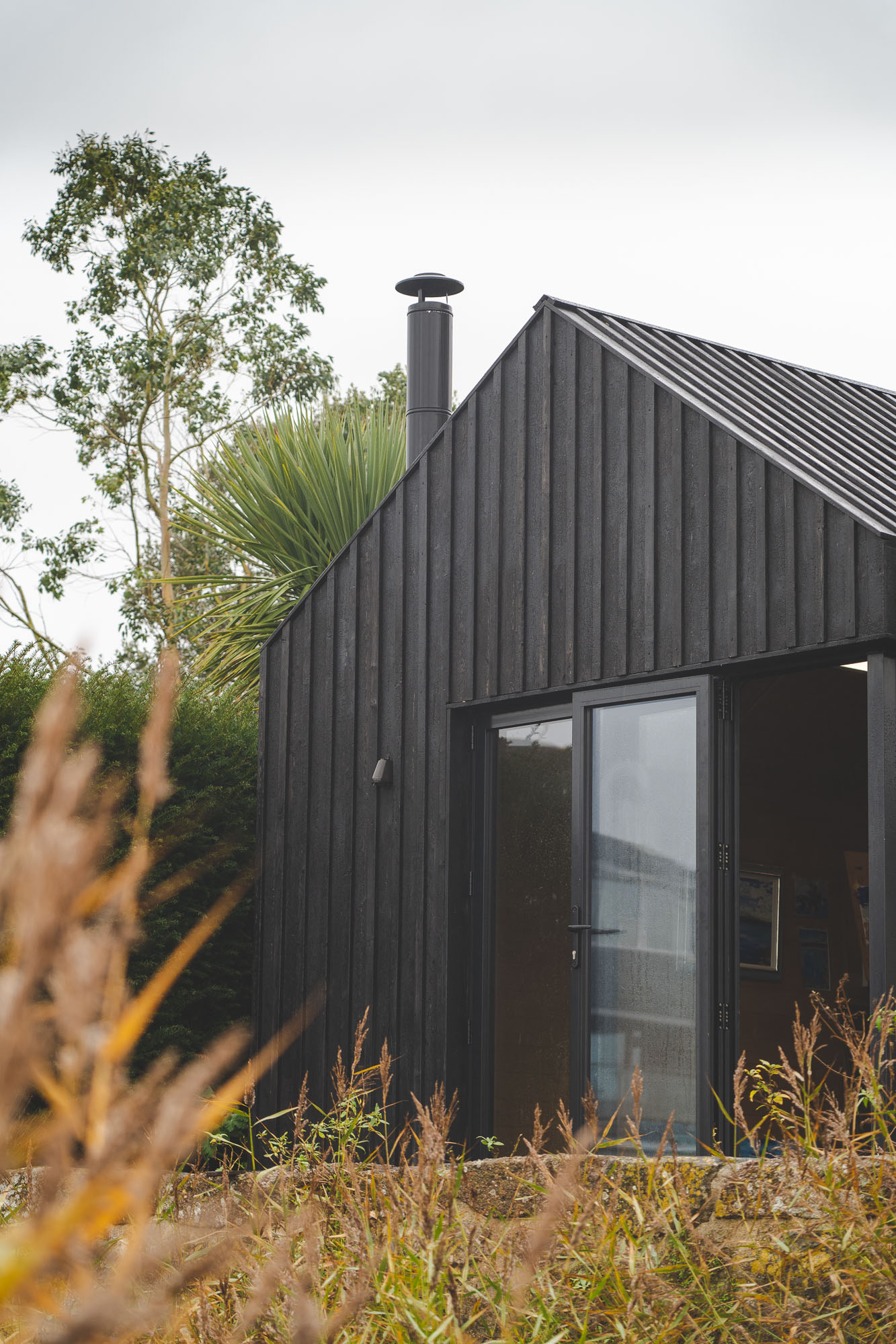 wooden office cabin with shou sugi ban cladding and bi-fold doors