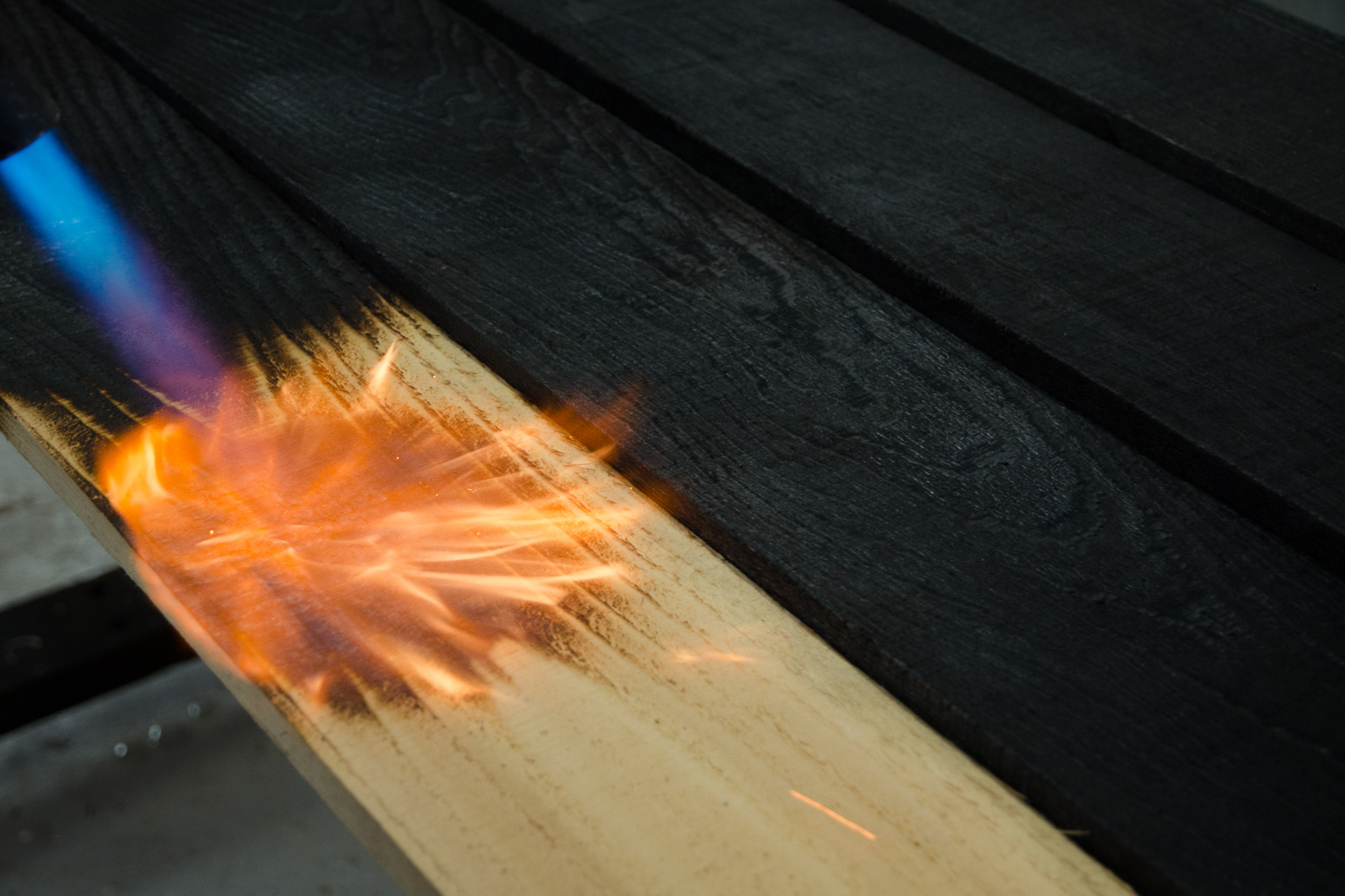 burning wood using blow torch to make shou sugi ban cladding