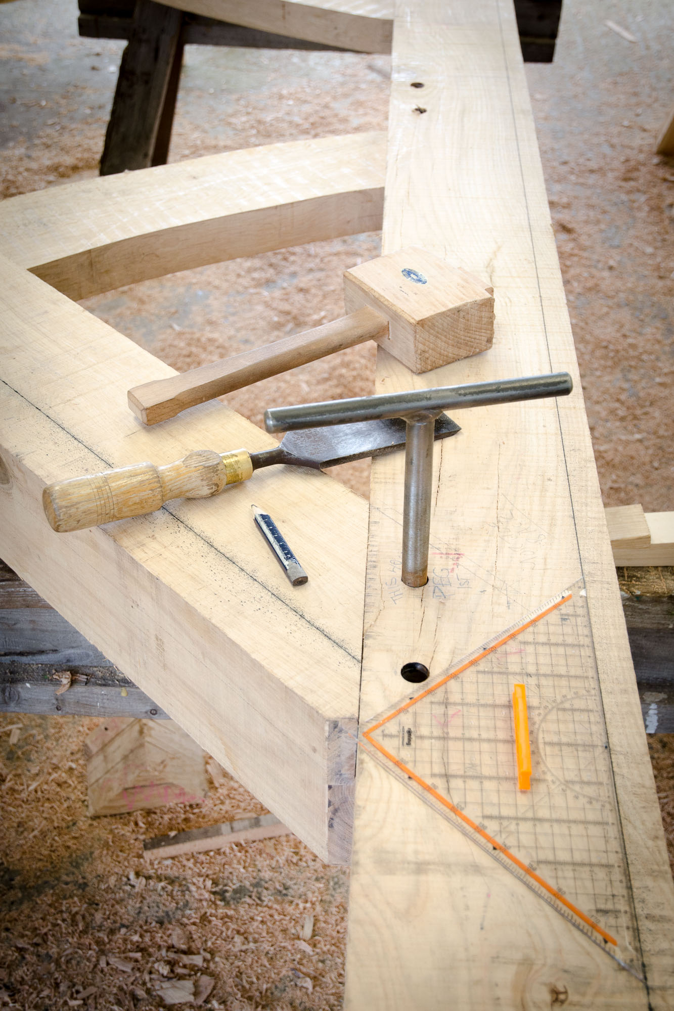cabin building with oak timber framing using chisels and hammer