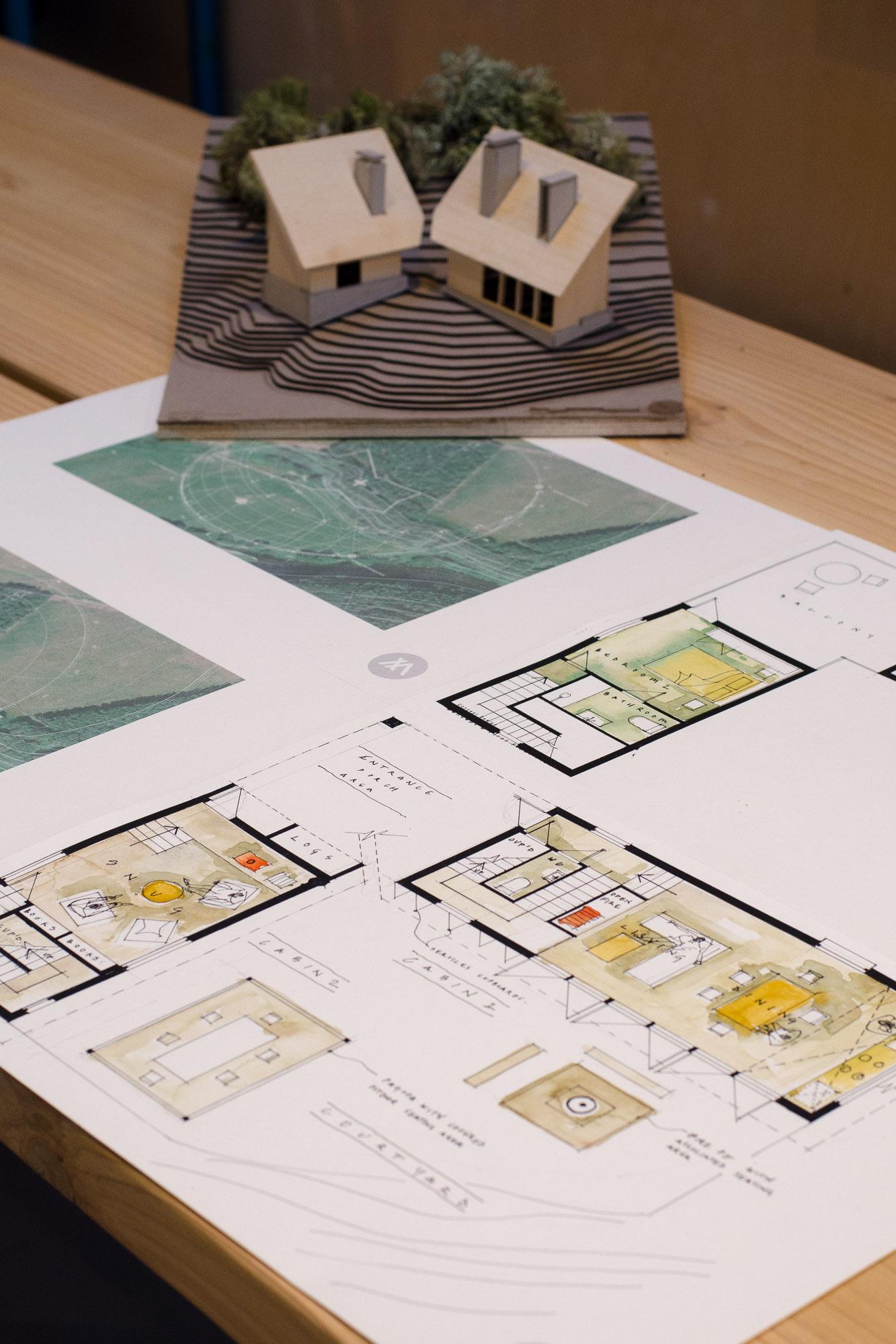 off-grid wooden cabin design sketch with model