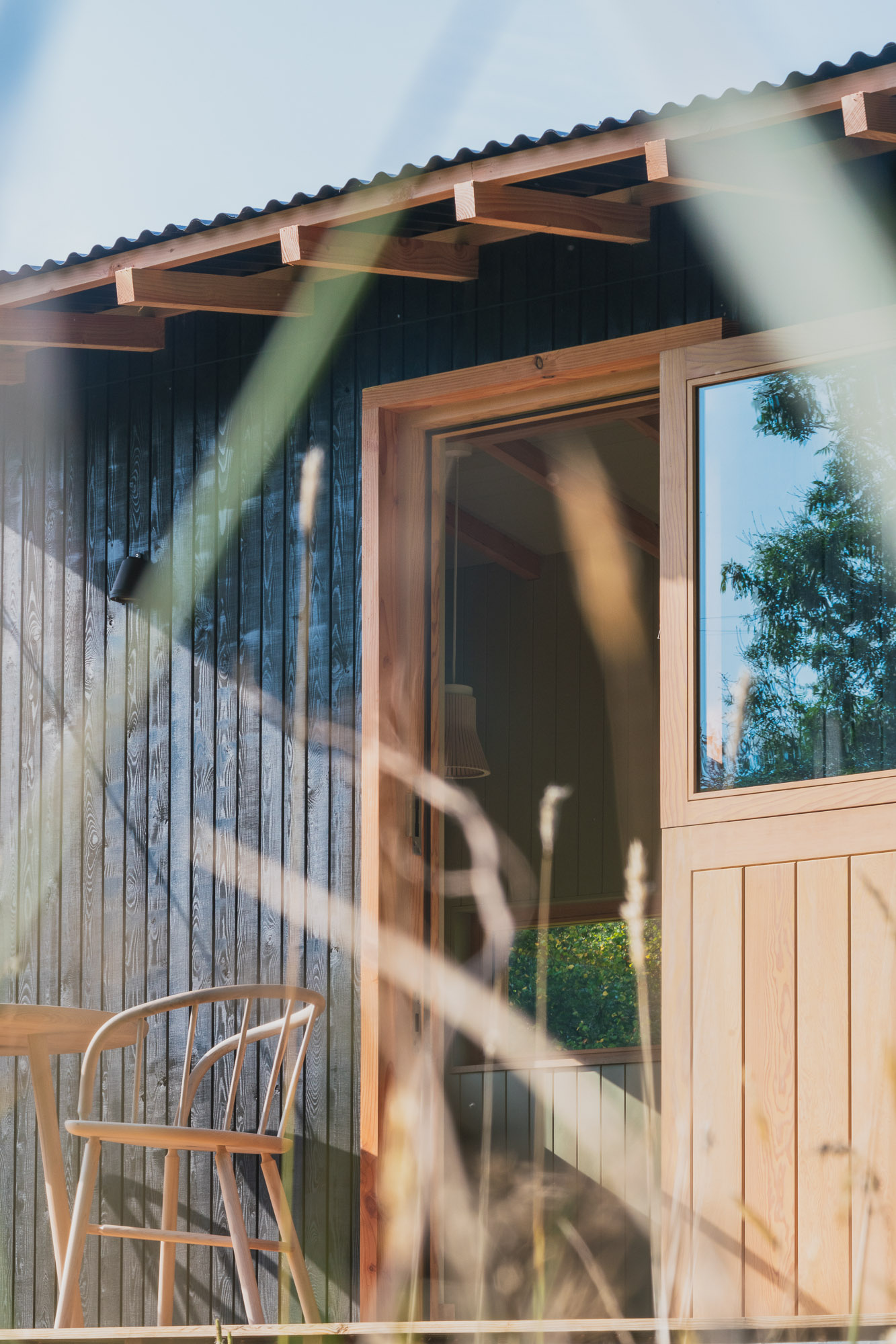 off grid tiny wooden nomad cabin office with black cladding and stable door